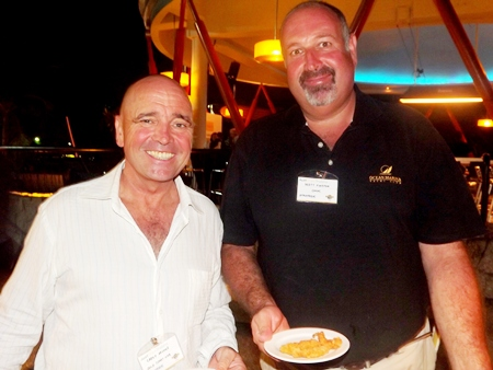 Carey Archer from Gold Coast Web and Scott Finsten from OMYC tuck into the great food put on by Hard Rock.
