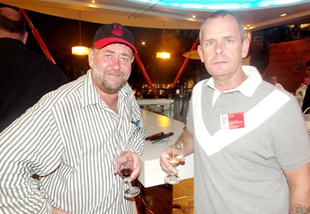 Mel Hand and Jon Fox from Q Cars Thailand aren't debating beer and wine, but white and red.