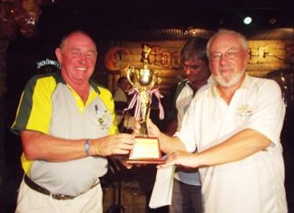 Bob Philp (left) receives the Thai Garden Resort Cup from rival captain, Helmut Wolf.