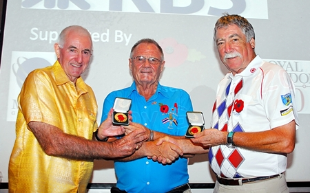 The Chairman, Derek Brook (center) presents  special medals from The Royal British Legion to tournament winners Les Charles & Barry Oats.