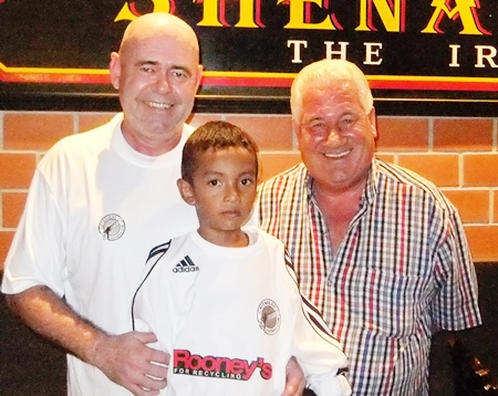 Former Gateshead and Blyth Spartans goalkeeper George Alberts and Shenanigans Manager Stewart Fraser have set up the first Gateshead Supporters Club in Asia at Shenanigans Bar in Jomtien.  Seen in the picture are George, Stewart and his adopted son Inn in Gateshead shirts ahead of this week's 1st Round FA Cup match between Blyth and Gateshead.  Gateshead's finest FA Cup run was ended 0-1 at home to Bolton Wanderers (the year of the Matthews Final) in a quarter final tie in 1953.  Gateshead beat Liverpool 1-0 in this remarkable FA Cup run.