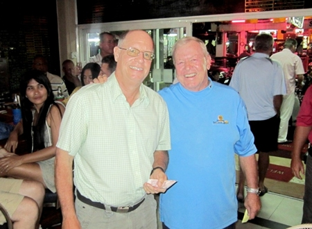 Brian Gabe (left) was glad he bought a ticket as he accepts the 50/50 prize from PSC Golf Chairman, Joe Mooneyham.