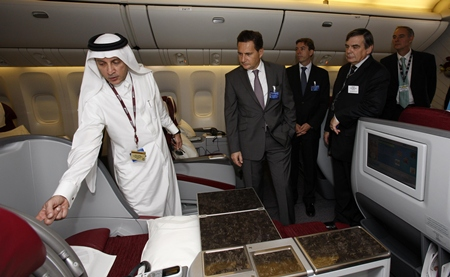 Qatar Airways Chief Executive Officer Akbar Al Baker, left, with French Minister of Industry, Energy and the Digital Economy, Eric Besson, onboard one of the airline's Boeing 777's on static display at the Dubai Air Show.