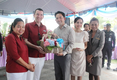 Michael Delargy (2nd left), GM of the Sheraton Pattaya Resort, together with Rojjana Franzke (left), executive assistant manager and Penpapasorn Eamsa-ard (right), senior sales manager presents a gift to Mayor Itthiphol Kunplome and his wife Rachada Chatikavanij (2nd right) on the occasion of his birthday which was celebrated at his home earlier this month.