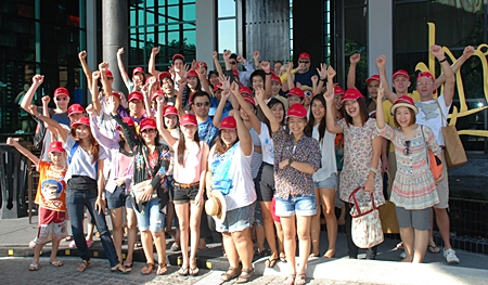 The Red team poses for a photo in front of Mantra Restaurant & Bar before boarding the boats.