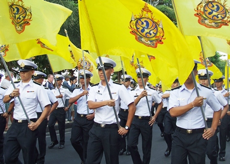 Raja Navy Commercial School cadets proudly fly HM the King's special birthday flag during the parade down Pattaya Beach Road.