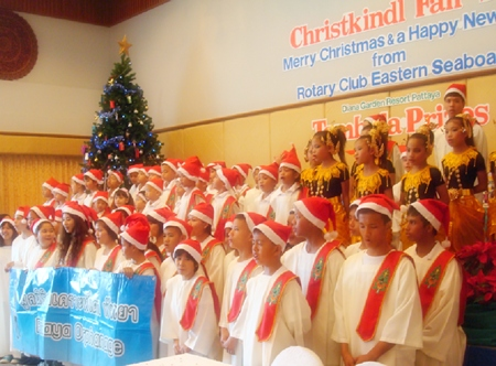The adorable Pattaya Orphanage Choir performs superbly.