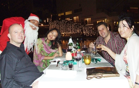 Santa pays a visit to a fun table during the Pullman Pattaya Aisawan Resort and Spa's celebrations of Christmas.