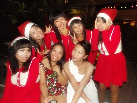 Santa's helpers visit some honored guests at Jomtien Garden Hotel.