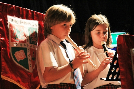 Josh Year 4 and Amber Year 5 playing recorders.
