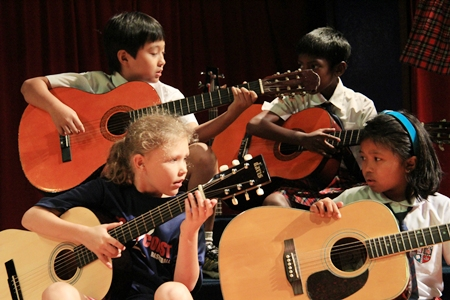 """The """"Craze"""" guitarists playing an original music piece."""