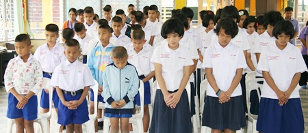 The students stand for a minutes silence in memory of Miss Caulfield.