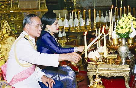 His Majesty King Bhumibol Adulyadej and Her Majesty Queen Sirikit attend a merit making ceremony for deceased royal family memebers at the Audience Hall of Amarindra Vinitchai at the Royal Palace, Bangkok June 8, 2006.