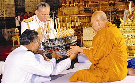 His Majesty the King attends a merit making ceremony for deceased royal family members at the Audience Hall of Amarindra Vinitchai at the Royal Palace Thursday, June 8, 2006, in Bangkok.