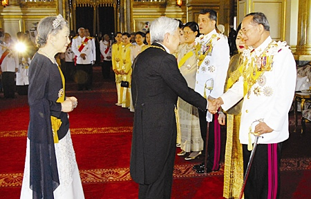His Majesty the King is congratulated by Japanese Emperor Akihito, as HM Queen Sirikit, partially hidden, and Japanese Empress Michiko look on at the the Ananda Samakhom Throne Hall in Bangkok Monday, June 12, 2006.