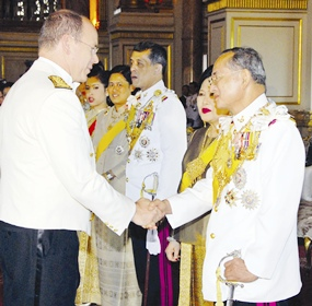 His Majesty the King is congratulated by Monaco Prince Albert II as HM Queen Sirikit looks on at the Ananda Samakhom Throne Hall in Bangkok Monday, June 12, 2006.