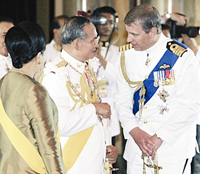 His Majesty the King and HM Queen Sirikit speak with Britain's Prince Andrew during a celebration in Bangkok Monday, June 12, 2006.