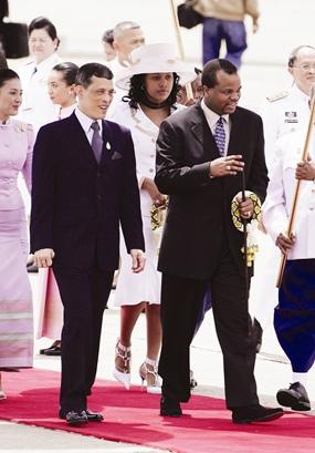 Swaziland's King Mswati III walks along with HRH Crown Prince Maha Vajralongkorn as he arrives at a military airport in Bangkok, Sunday, June 11, 2006.
