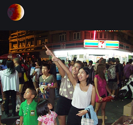 Pattaya denizens gather in the thousands to watch a total lunar eclipse on Constitution Day, Dec. 10.  The full moon turned blood red during the last total lunar eclipse until 2014.