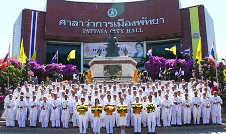 Mayor Itthiphol Kunplome and friends gather over 100 novice monks in front of City Hall in honor of HM the King's birthday.