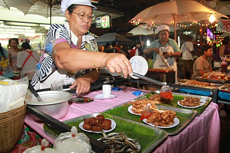 A market vendor serves up some fresh local food at Naklua's 3rd new Walking Street project.