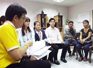 Maneeporn Phukrongthung and her husband Namchai (both seated right) listen to Dr. Narongsak Ekawatnakul (left), director of Banglamung Hospital as he tries to explain what happened.