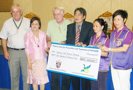 The benevolent groups donate 200,000 baht to Dr. Philippe Seur.