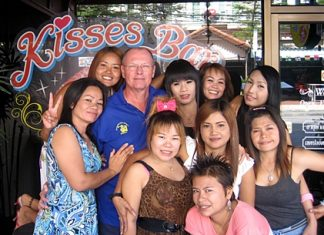 Dan M celebrates his win with the staff outside Kisses Bar.