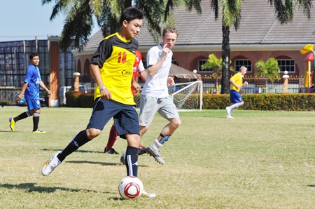 Fairway take on Regent's Pattaya in the PICC Charity Cup Football Tournament.