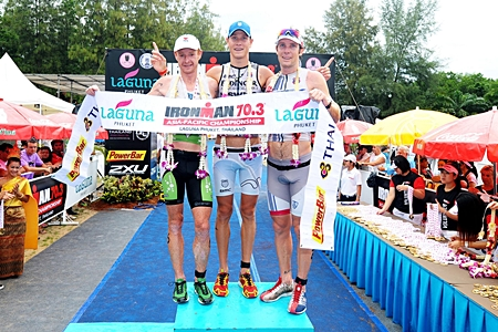 2011 Ironman 70.3 Asia-Pacific Championship winner Michael Raelert of Germany on the podium at Laguna Phuket with runner-up Richie Cunningham (left) and third-placed Paul Matthews (right), both of Australia.