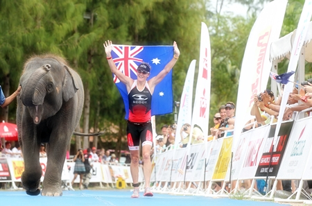 Reigning Ironman 70.3 World Champion Melissa Rollison of Australia celebrates her victory at Laguna Phuket in the Ironman 70.3 Asia- Pacific Championship.