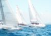 'Team Premier' (left) attempts to make up ground on 'Freefire' (center) and 'Hi Fi' (right) during the final day of racing at the 25th Phuket King's Cup Regatta.