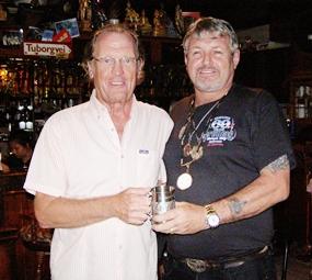 Peter Hammond (left) receives his Cafe Kronborg December Monthly Mug from Bjarne.