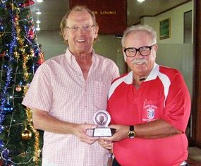 Peter Hammond (left) receives the 2011 Xmas Fayre Trophy from Dave Richardson.