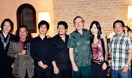 (From left): Neil Muir, Dennis Dila, Pongsakorn Lertsakorakul, Pumrat Ryukaewma, Richard Harvey, Xuefei Yang, and Silver Lake owner Surachai Tangjaitrong pose for a photo at the conclusion of the concert at Silver Lake Vineyard, December 28, 2011.