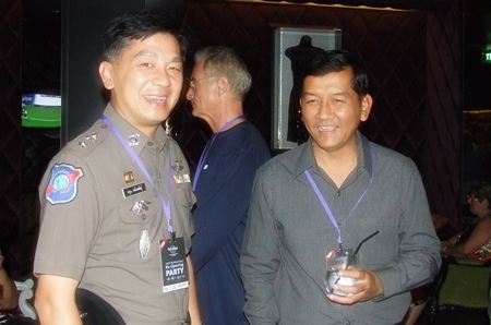 Pol. Col. Aroon Promphan Chief Inspector of the Pattaya Tourist police enjoys a laugh with Chaowalit Saeng-Uthai, head of Banglamung District.