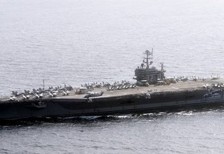 Official U.S. Navy file photo of the Nimitz-class aircraft carrier USS Abraham Lincoln (CVN 72) underway in the U.S. 7th Fleet area of responsibility as part of a deployment to the western Pacific and Indian Oceans en route to support coalition efforts in the U.S. 5th Fleet area of responsibility. (U.S. Navy photo by Mass Communication Specialist 3rd Class Adam Randolph/Released)
