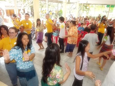 The sailors are invited to participate in a Thai circle dance.