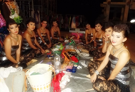 Lovely dancers await their turn to take the stage at Lan Pho Public Park in Naklua.