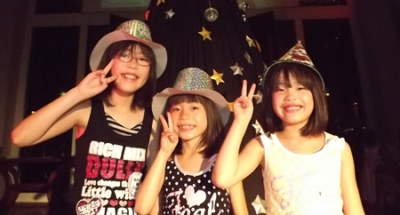 Youngsters salute the New Year at Town in Town Hotel.