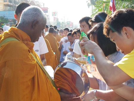 Monks receive alms along Jomtien Beach Road early in the morning on Jan. 1, 2012.