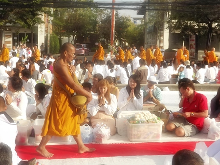 Over 2,000 monks receive alms from over 20,000 humble followers.
