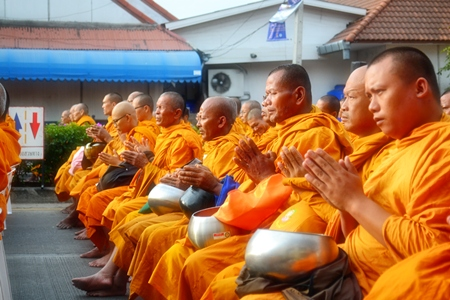 Bathed in the early morning light, monks pray for their brethren in the South.