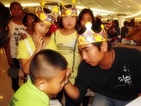 Having your face painted is a time honored ritual on Children's Day at the Royal Garden Plaza.