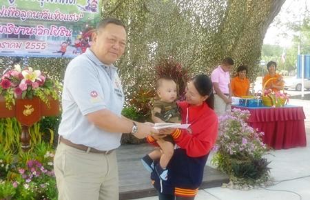 Vice Adm. Phongsak Phureeroj hands out awards at the navy's annual children's day celebration in Sattahip.