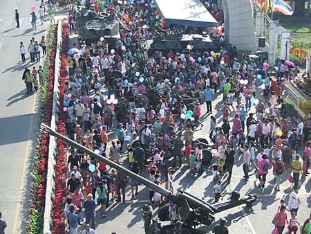Thousands of children and their families create a busy atmosphere in front of Pattaya City Hall.