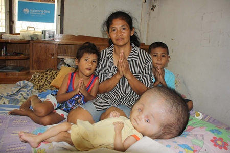 The Oumprasert family prays for a better future for young Nopakorn.