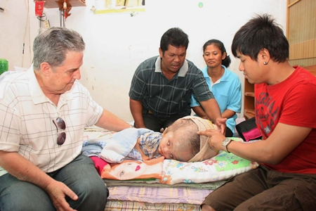Thanks to American Dr. Howard Resnick (left), young Nopakorn might actually have a future filled with much less pain and suffering.