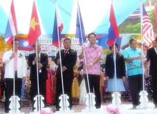 Mayor Itthiphol Kunplome and other officials plant flags to officially open the new ASEAN study center at Pattaya School #4.