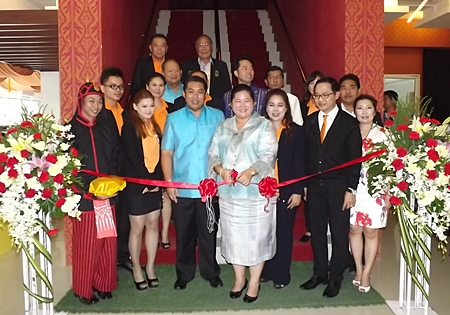 Culture Minister Sukumol Kunplome cuts the ribbon to officially open the new Miniature Thai Royal Barge Performance Center.